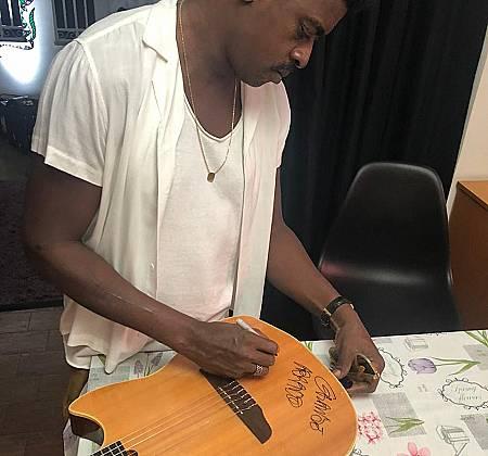 Seu Jorge Autographed Guitar